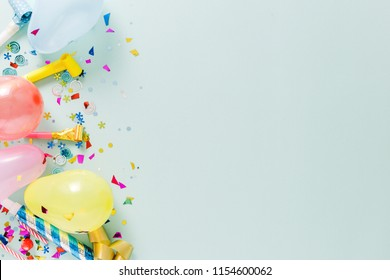 Flat lay decoration party concept on pastel blue background with copy space top view