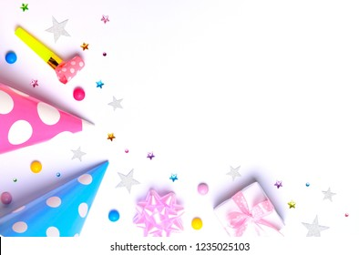Flat lay decoration party concept on white background. Top view, copy space.