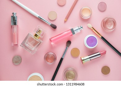 Flat lay of decorative cosmetics and tools on pink background. Beauty concept.