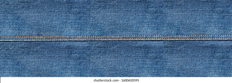 flat lay, denim jeans leg seam detail, background texture, copy space