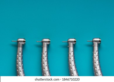 Flat lay of dental high-speed handpieces on the blue background