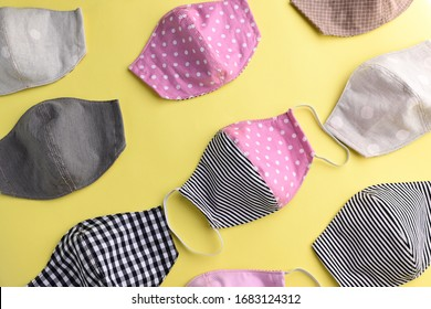 flat lay design of colorful fashion face mask handmade from fabric cloth on yellow background
