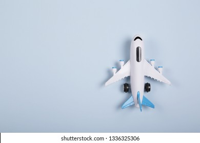 Flat lay design of travel concept with plane on blue background with copy space. Summer vacation.