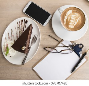 Flat lay desk with coffe and cake mock up