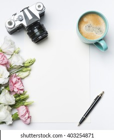 flat lay- desk with coffee and flowers