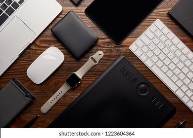 flat lay with different devices on wooden workplace