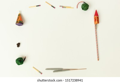 Flat lay of different types of Diwali Firecrackers arranged in frame for copy space on isolated background