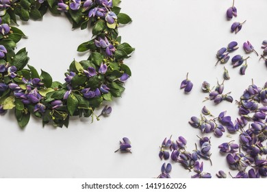 flat lay DIY midsummer flower wreath on white background