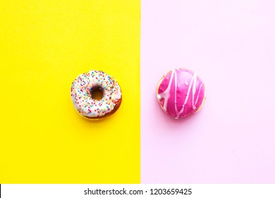 Flat lay donuts on a yellow background. Top view