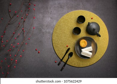 Flat lay east asian afternoon tea on rustic grey background.