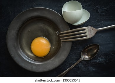 Flat lay eggs in pewter dish