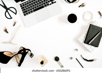 Flat lay fashion blogger black styled desk frame with laptop and woman accessory collection on white background. Top view.