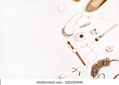 Flat lay fashion concept. Female accessories on white background. Top view.