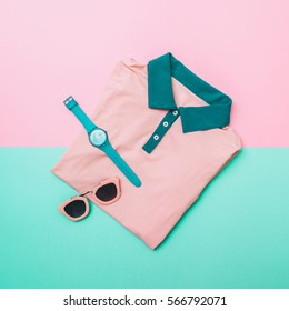 flat lay fashion set of pink shirt, sunglasses and mint watches. pastel fashion in trend. minimal.