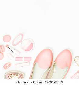 Flat lay of female fashion accessories, shoes, makeup products and handbag on pastel color background. Beauty and fashion concept