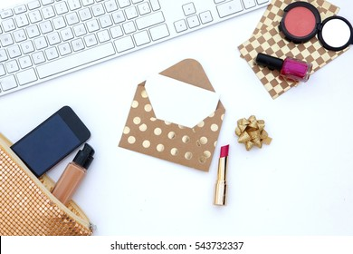 Flat lay. Feminine scene. Wedding background. envelope., laptop.cosmetic  bag, lipstick