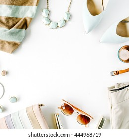 flat lay feminini clothes and accessories collage with cardigan, trousers, sunglasses, watch, bracelet, lipstick, mint high heel shoes, earrings and purse on white background.