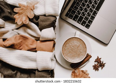 Flat lay. Fragrant cup of coffee in autumn style. Delicate and cozy sweater sleaves
