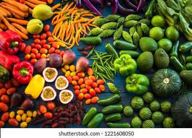 Flat lay of fresh  fruits and vegetables organic for background, Different fruits and vegetables for eating healthy, Colorful fruits and vegetables on blue plank background