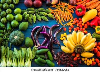 Flat lay of fresh  fruits and vegetables for background, Different fruits and vegetables for eating healthy, Colorful fruits and vegetables on blue plank