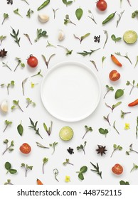 Flat lay fresh vegetables, herbs and spices with a empty white plate on white background. Text space images.