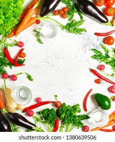 Flat lay with fresh vegetables and pure water on a white background