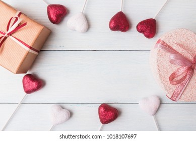 Flat lay of gift boxes and decoration over light wooden background on Valentines day