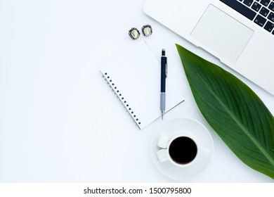 Flat lay girly, pale black items for planning, notepads, pens, office work or working at home on her laptop, on the pale white background, with place for labels. Concept Desk.