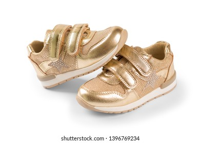 flat lay. the gold children's sports shoes isolated on a white background
