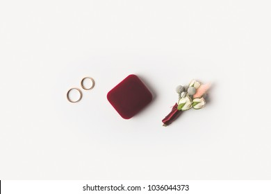flat lay with grooms accessories, buttonhole, gift and jewelry box on wooden surface