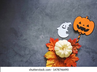 Flat lay of halloween prop for decoration and party on dark stone background with copy space, holiday concept