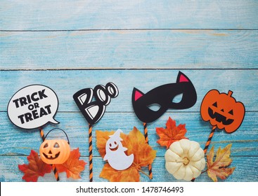 Flat lay of halloween prop for photo booth and party on blue wooden background with copy space, holiday concept