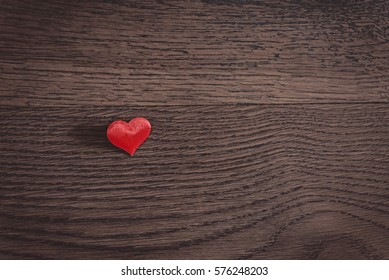 flat lay heart on a wooden background with copy space