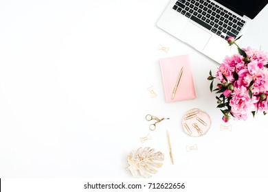 Flat lay home office desk. Woman workspace with laptop, pink peonies bouquet, golden accessories, pink diary on white background. Top view feminine background. Women home office desk concept.