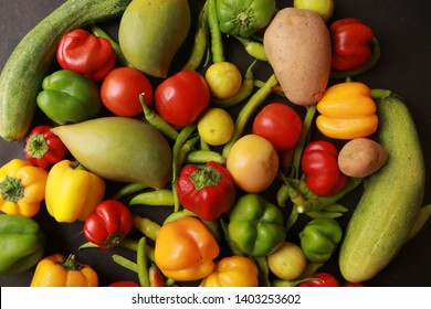 Flat lay of huge group of fresh vegetables and fruit on color full background - Vegetables VS Fruit - High quality studio shot - Flat lay