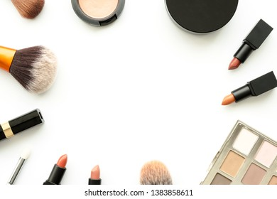 Flat lay image of beauty cosmetics make up with lipsticks, eye shadow palette, blush on, powder and brush. Top view with copy space, for your text.