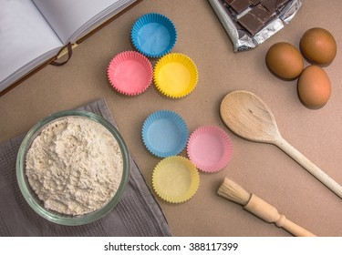 Flat lay image of the ingredients for baking cupcakes