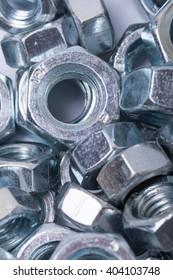 Flat lay image of metal grey nuts.
