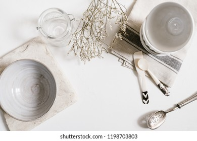 flat lay of kitchen pottery with natural tones and materials