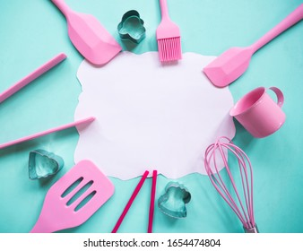 Flat lay of kitchen tools and ingredients for cake, cookies, bakery on colorful background with blank space for text.