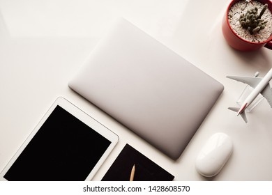 Flat lay of laptop, tablet and notbook, equipment for workplace concepts