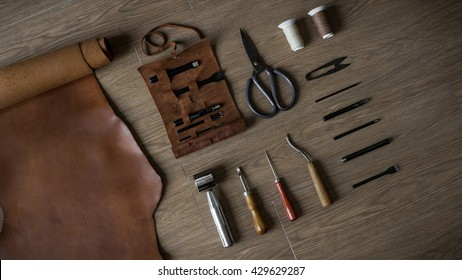 Flat Lay of Leather Craft Tools in Retro Style