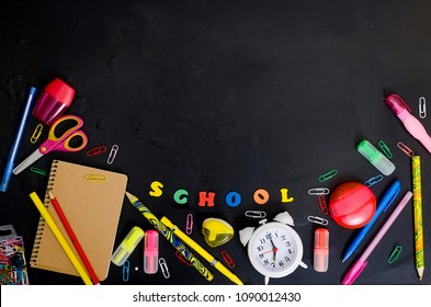 Flat lay with lettering back to school and set of school equipment on blackboard - Shutterstock ID 1090012430