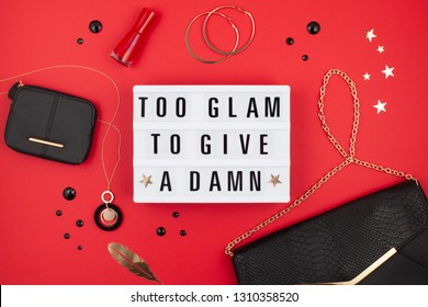 Flat lay of  lightbox with funny motivation, inspiration phrase Too glam to give a damn