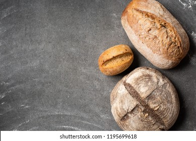 flat lay with loafs of baked bread on grey tabletop