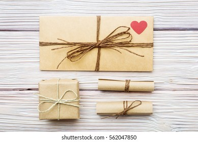 Flat lay of love letters and gift box in old style.