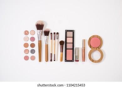Flat lay makeup set isolated on white background