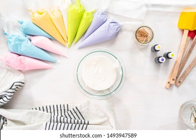 Flat lay. Making royal icing to decorate Easter sugar cookies.