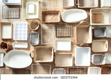 Flat lay of Marie Kondo's storage boxes, containers and baskets with different sizes and shapes for tidying up wardrobe. KonMari method organizer boxes set. Closet organizing concept. - Shutterstock ID 1853751964