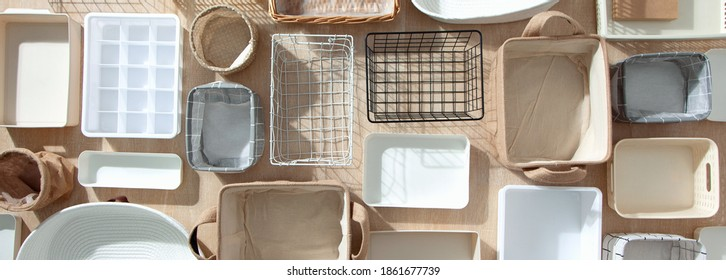 Flat lay of Marie Kondo's storage boxes, containers and baskets with different sizes and shapes for tidying up wardrobe. KonMari method organizer boxes set. Closet organizing concept.